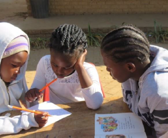 Teaching children in small groups at the Holiday Reading Club