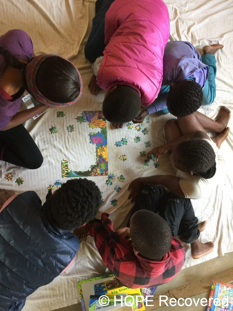 Kids Club for vulnerable children - Playing puzzles improves visual competencies